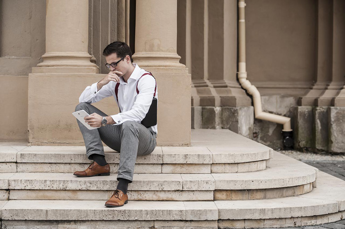 guy with black tablet holster reading a tablet-1280